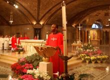 Br Richard reads the Gospel