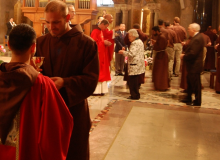 Br. Manuel offers the Precious Blood to Br. Chris