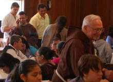 Fr. Francis (r) mingles while Manuel is 'called'